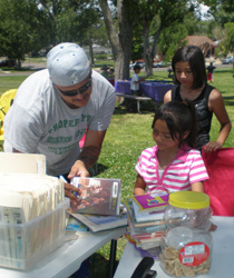 Since 2004, the Pueblo City-County Library has offered Books in the Park, a program that brings books and fun programming to parks that serve free lunches to kids through the Summer Food Service Program.