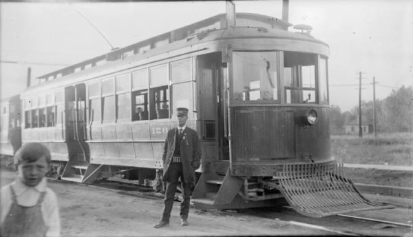 historic photo of Denver streetcar, its conductor, and a young boy